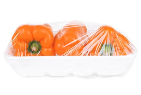 Plastic packaging and orange peppers